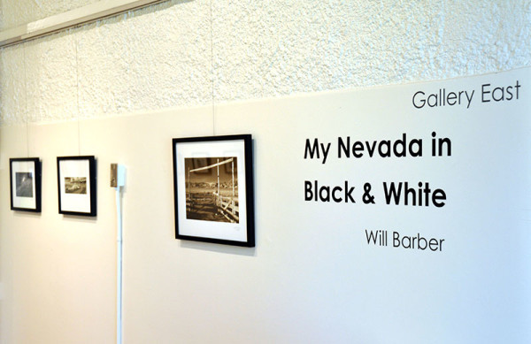 Wall with black and white framed photos in McKinley Art Gallery
