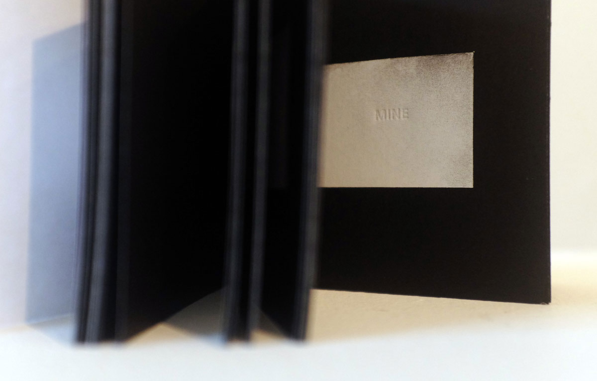 Publication artwork that show the word mine on silver paper