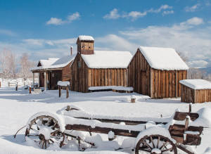 Bartley Ranch Regional Park with snow covered buildings and old farm equipment