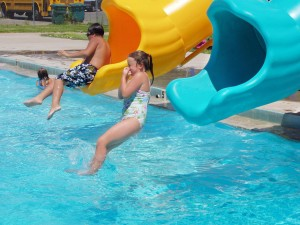 Traner Pool with kids sliding down slides