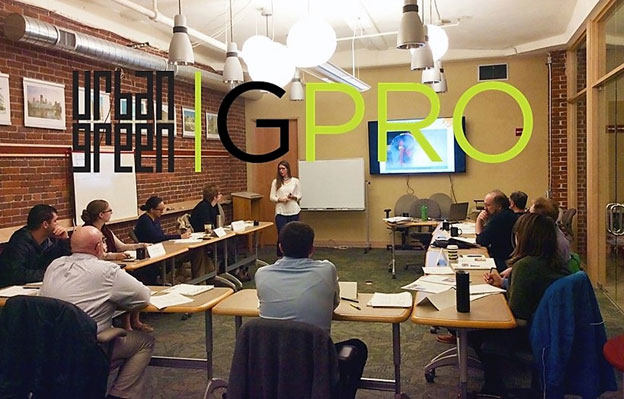 Conference room with people and Urban Green GPRO text on top of image
