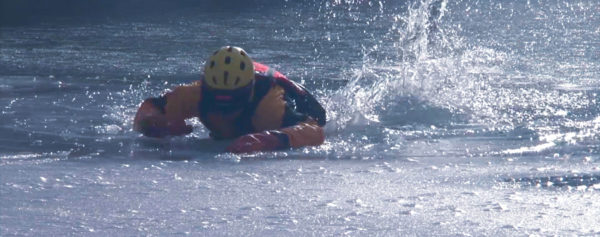 Reno firefighter in water and ice training