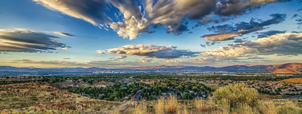 Blue sky over the City of Reno with the mountains in the background